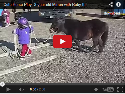 Cute Horse Play: 3 year old Mirren with Ruby the Shetland Pony, UK